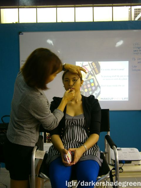 Demonstrating how to shape eyebrows